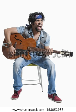 Musician playing a guitar