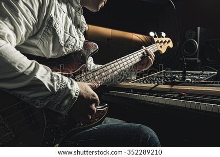 Musician playing electric guitar - stock photo