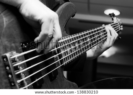 Musician playing on bass guitars. - stock photo