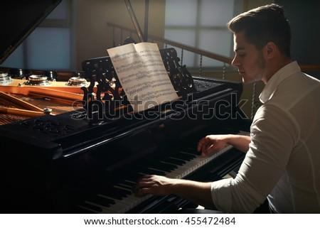 Musician playing piano - stock photo
