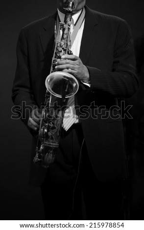 Musician Playing Tenor Saxophone - stock photo
