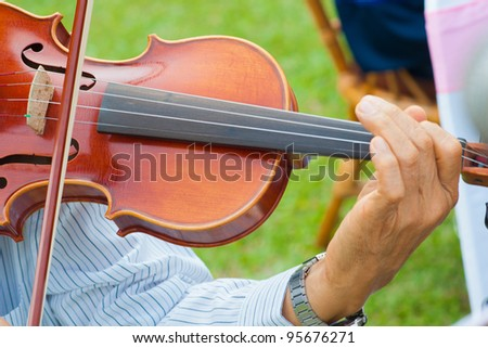 Musician playing violin - stock photo