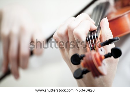 Musician playing violin isolated on white - stock photo