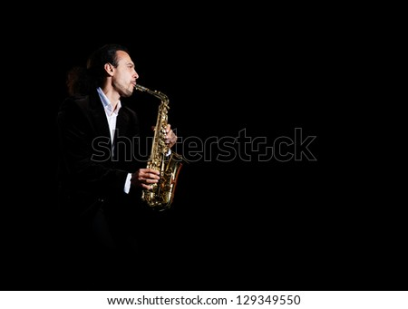 musician plays at sax - stock photo