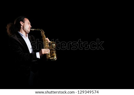 musician plays jazz at saxophone