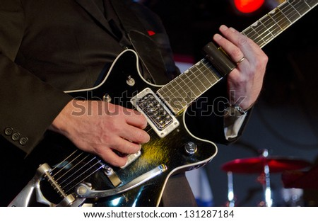 Musician plays the electric guitar at a blues festival - stock photo