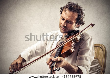 musician plays violin - stock photo
