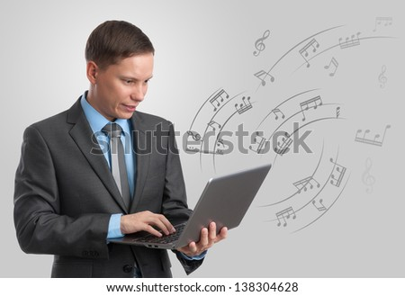 musician with laptop. multimedia concept - stock photo