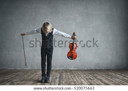 Musician with violin in studio