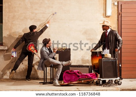 musician writes on the wall - stock photo