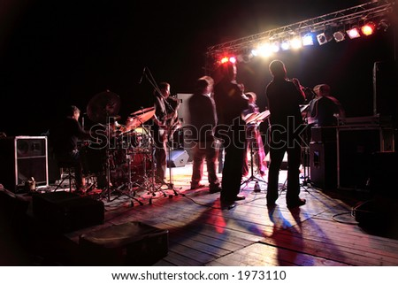 musicians are playing on stage - motion blur