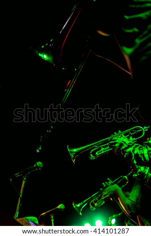 Musicians blow the saxophone on stage.