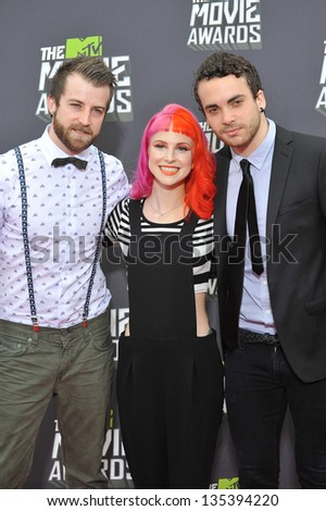 Musicians Jeremy Davis, Hayley Williams & Taylor York of Paramore at the 2013 MTV Movie Awards at Sony Studios, Culver City. April 14, 2013  Los Angeles, CA Picture: Paul Smith - stock photo
