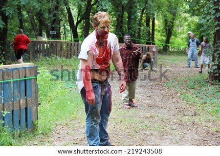 MUSKOGEE, OK - Sept. 13: A bloody zombie in ripped clothing waits for the next runner during the Castle Zombie Run at the Castle of Muskogee in Muskogee, OK on September 13, 2014.