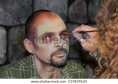 MUSKOGEE, OK - Sept. 13:  Actors get make-up to look like zombies for the Castle Zombie Run at the Castle of Muskogee in Muskogee, OK on September 13, 2014.  - stock photo