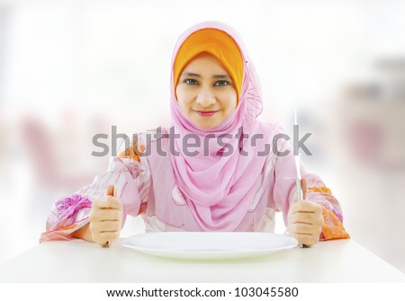 Muslim an and empty food for fork holding inside knife plate ready restaurant with woman