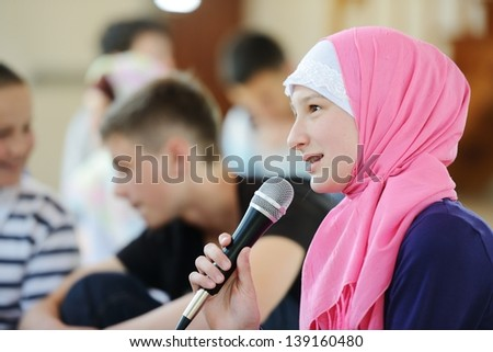 Muslim and Arabic girls learning together in group - stock photo