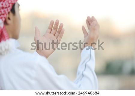 Muslim Arabic boy praying - stock photo