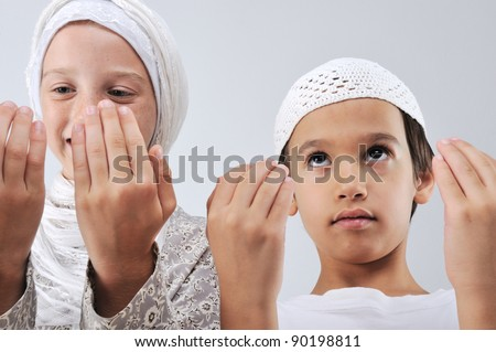 Muslim arabic brother and sister praying together - stock photo