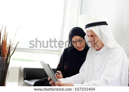 Muslim Arabic couple using Tablet computer - stock photo