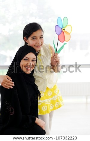 Muslim Arabic mother and daughter - stock photo