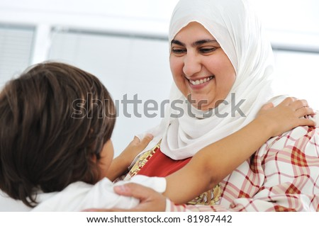 Muslim arabic mother and son - stock photo