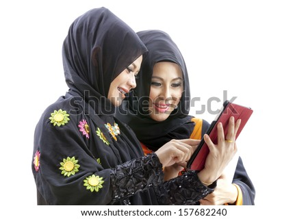 Muslim asian female student with tablet computer  - stock photo