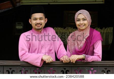 muslim couple with greeting hari raya - stock photo