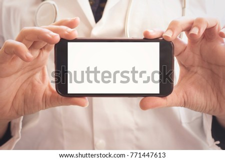 muslim doctor woman holding mobile phone and showing it to camera