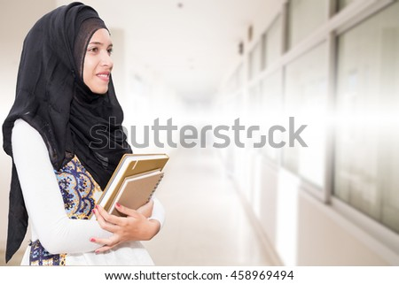 Muslim female in office - stock photo