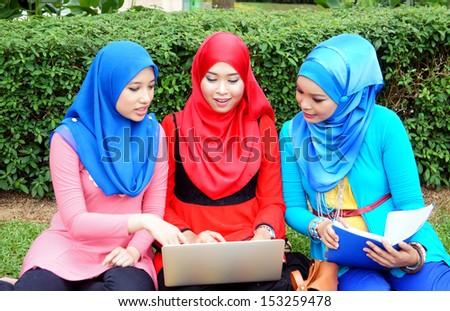 Muslim girl discuss study at park - stock photo