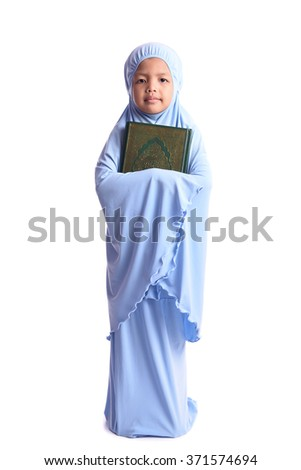 Muslim Girl Loves Holy Book of Quran Isolated on White Background - stock photo