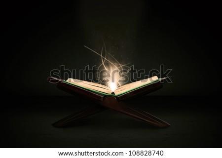 Muslim holy book of koran shot in studio - stock photo