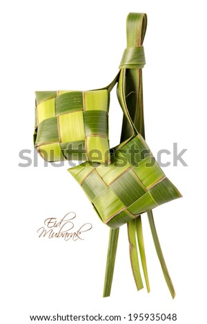 Muslim Ketupat (Rice Dumpling) with Clipping Path. Translation: Eid Mubarak - Blessed Feast - stock photo