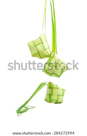 Muslim Ketupat (Rice Dumpling) with Clipping Path. Translation: Eid Mubarak - Blessed Feast Ketupats, a natural rice casing made from young coconut leaves for cooking rice on white background - stock photo