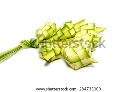 Muslim Ketupat (Rice Dumpling) with Clipping Path. Translation: Eid Mubarak - Blessed Feast - stock photo