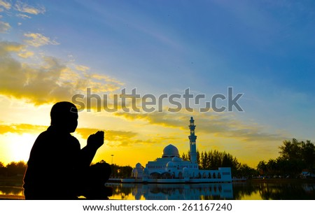 muslim kid prayed during sunset  - stock photo