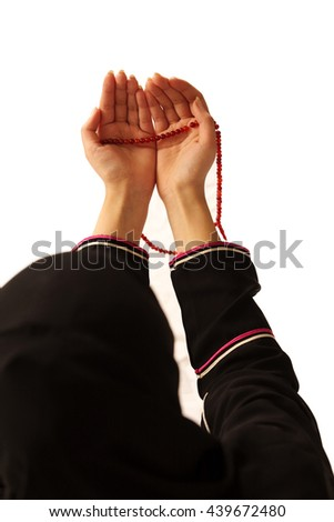 Muslim lady praying with open hands - stock photo