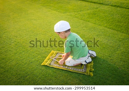 Muslim little kid praying - stock photo