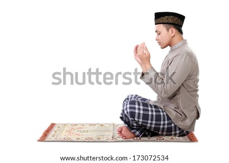 muslim man doing prayer isolated over white background - stock photo