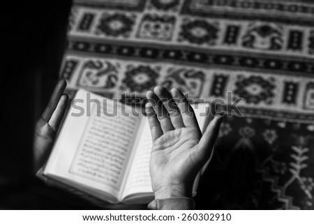 Muslim Man Is Reading The Koran - stock photo