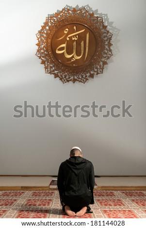 Muslim Man Praying At Mosque - stock photo