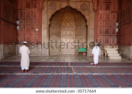 Muslim mosque and prayers - stock photo