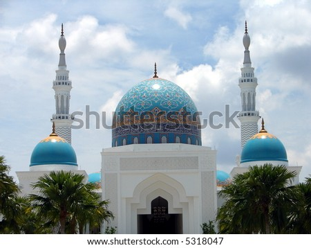 Muslim mosque with arabic words written on dome - stock photo