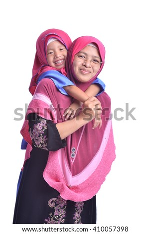 Muslim Mother and her daughter, isolated on white - stock photo