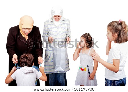 Muslim mothers bought presents for their kids - stock photo