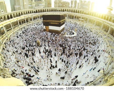 Muslim people praying at Kaaba in Mecca - stock photo