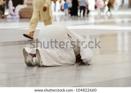 Muslim praying in Medina mosque outdoor - stock photo