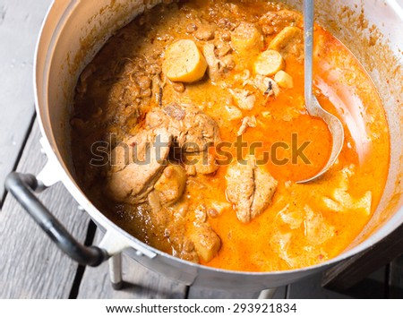 Muslim style chicken and potato curry or chicken mussaman curry in the pot