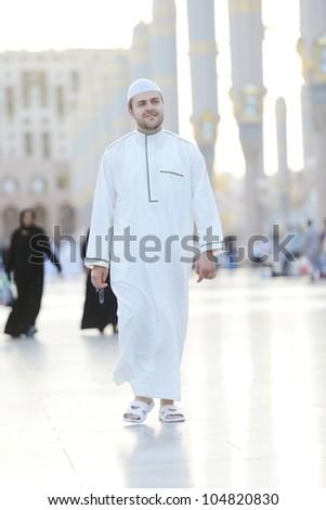 Muslim walking in Medina haram - stock photo
